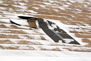 damaged roof blown by strong winds - wind mitigation inspection miami
