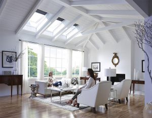 Home Inspectors Miami a living room area with white wall color and a skylight