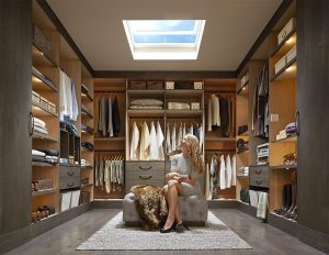 Miami Home Inspectors a woman inside a big closet room with skylight