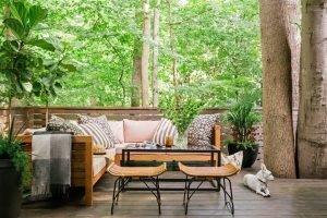 Home Inspectors Miami a deck with the right furnitures and lot of trees in the surroundings