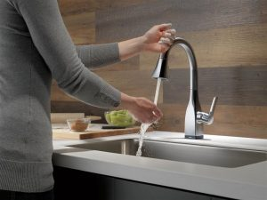 Miami Home Inspectors woman washing her hands in the faucet