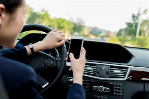 using phone while driving - home inspection miami