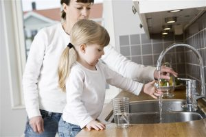 mother and daughter on the kitchen sink - home inspection miami